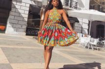 African girl in halterneck short ankara dress with white sneakers