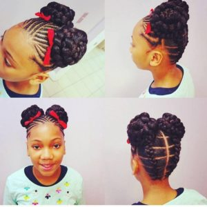Little black girl with cornrows in front and stitch braids at the back, leading to two braided buns in the middle