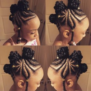 Little girl with creative cornrow braids forming three braided buns