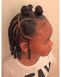 Little black girl with natural hair braided and twisted into Bantu knots