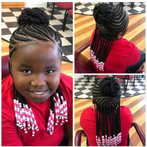 Little girl with cornrows in the half up half down updo style with beads