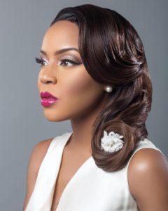 Nigerian bride with a a beautibulf half up half down bridal hairstyle