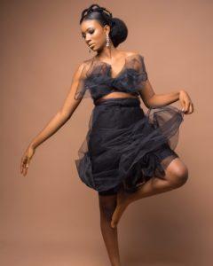avant garde wedding hairstyle, african threading and kinky low bun