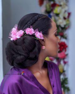 creative low bun wedding hairstyle with flower wedding hair accessories