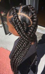 black girl wearing jumbo box braids style