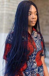 black woman wearing long black twists microbraids box braid styles