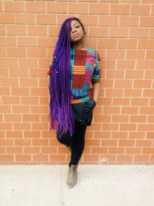black girl wearing very long purple box braids hairstyle