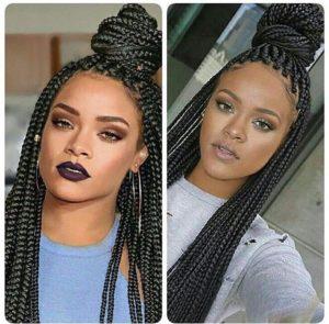 Rihanna wearing black box braids hairsstyle with a bun on top