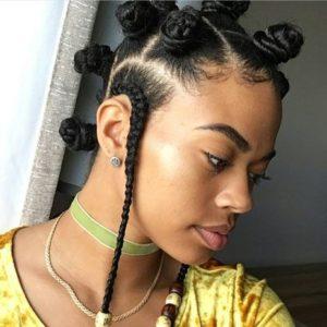 black girl wearing bantu knots and cornrows