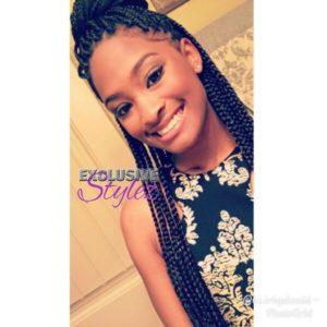 black woman wearing box braids in half up half down style