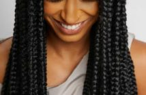 black woman wearing long box braids