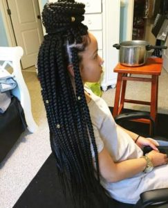 girl with box braids and gold accessories, black braided hairstyles